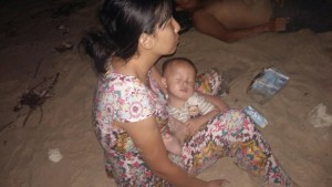 Baby Xiaobao and his mother, Gu Giao, shipwrecked off the coast of Thailand.
