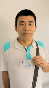 Chinese dissident Yan Bojun shows us his UN-issued ID card.